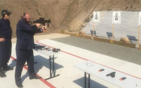David Elliot shooting a submachinegun